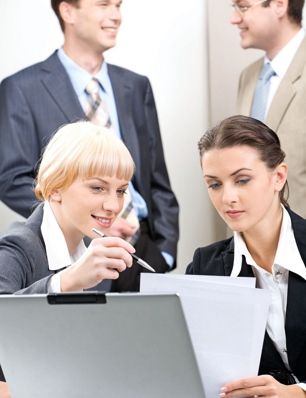 Business woman is giving a consultation to her colleague on the background of business people